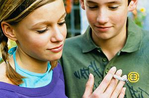 Teenage Boy and Girl Smoking